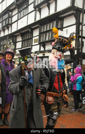 Rochester, Kent, UK. 1st December 2018: A couple dressed in Steampunk costume particiapte in the main parade on Rochester High Street. Hundreds of people attended the Dickensian Festival in Rochester on 1 December 2018. The festival's main parade has participants in Victorian period costume from the Dickensian age. The town and area was the setting of many of Charles Dickens novels and is the setting to two annual festivals in his honor. Photos: David Mbiyu/ Alamy Live News - Stock Image