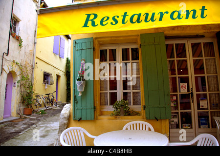 Arles; Bouches du Rhone, France; A restaurant in the centre with tables outside - Stock Image