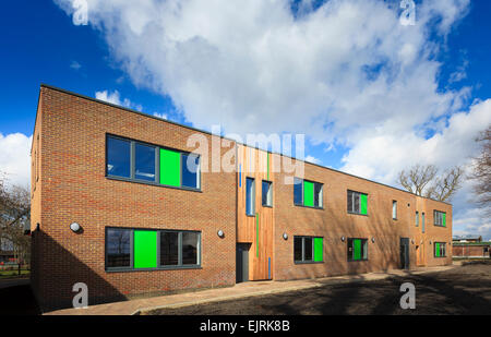 Modern timber clad and brick college building - Stock Image