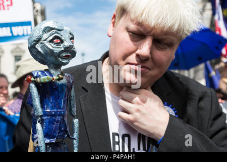 London, UK. 23 June 2018. Boris Johnson impersonator with a Theresa May puppet.  Remain supporters and protesters gather in Pall Mall for an Anti-Brexit March and Rally. Photo: Bettina Strenske/Alamy Live News - Stock Image