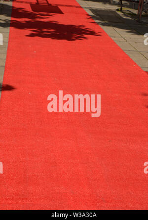 rolled out red carpet by day no people for an evening event, red carpet before an event - Stock Image
