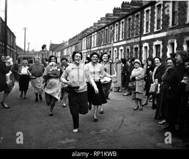 Pancake Day in Cardiff  A pancake race organised by the St Agnes Women Fellowship in aid of Congo Relief was held at Bertram Road, Roath, Cardiff.  Picture shows the finish of the over 40's race. 15th February 1961. - Stock Image