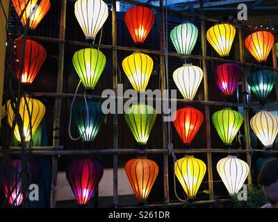 Different coloured lanterns in a grid for decoration - Stock Image