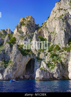 The White Grotto of the island of Capri, Italy.  Coastal Rocks on the island of Capri on the Tyrrhenian Sea. - Stock Image