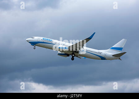 A Polish 737-8AS departing Inverness Dalcross airport in the Scottish Highlands, UK. - Stock Image