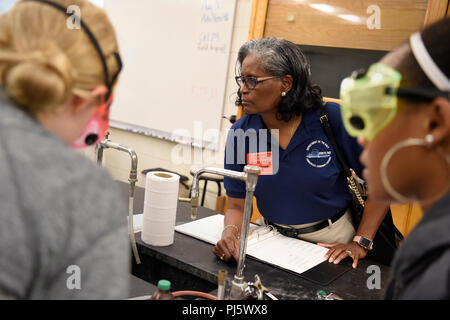 180828-N-PO203-0120 ATLANTA, Ga. (Aug. 28, 2018) Dr. GeorgiAnna Sheppard with the Office of Naval Research observes students in a honors chemistry class at Harrison High School in Kennesaw, Ga., during a Department of Navy (DoN) Historically Black Colleges and Universities/Minority Institutions (HBCU/MI) Program visit. During the first-ever high school outreach visit for the DoN HBCU/MI program, representatives discussed the Science and Engineering Apprenticeship Program (SEAP), which provides internships for high school students at Navy labs and warfare centers around the country.(U.S. Navy p - Stock Image