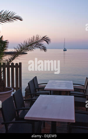 Yacht drifts serenely on the Mediterranean Sea - Stock Image
