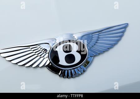 Monte-Carlo, Monaco - June 16 2019: Famous Bentley Winged 'B' Logo (Symbol) On The Bonnet Of A Luxury British White Car At Monte-Carlo, Monaco. Close - Stock Image