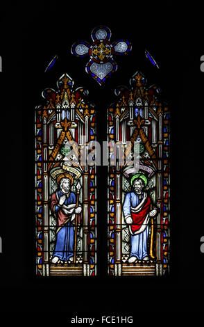 Stained glass window depicting Apostles St Thomas and St James the Less, All Saints Church, Beighton, Norfolk - Stock Image