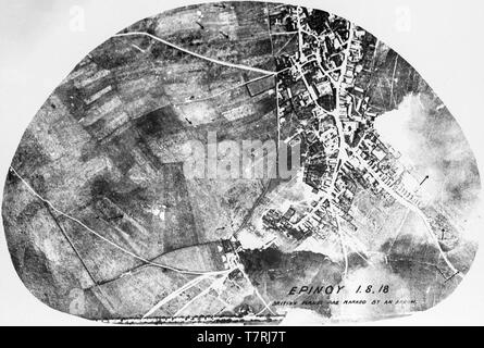 A contemporary British black and white aerial photograph showing  bombing of the town of Epinoy in Northern France on 1st August 1918. A number of British aircraft have been marked with arrows on the photograph. - Stock Image