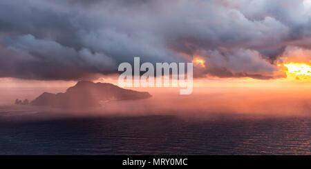 Capri, Napoli, Campania, Italy. Storm over Capri island at sunset - Stock Image