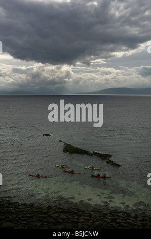 People sea kayaking in Applecross Wester Ross Scotland Picture by Ashley Coombes/Epicscotland - Stock Image