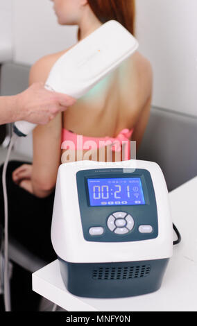young girl is undergoing treatment of skin diseases - Stock Image