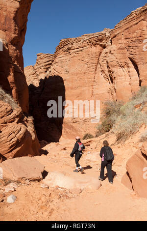 Navajo guide and woman hiker going into slot Canyon in Page Arizona - Stock Image