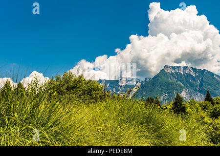 Mountain and summer clouds at Levico Terme, Trentino, Italy - Stock Image