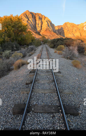 Narrow railroad tracks at Old Nevada, Red Rock Canyon, Nevada, USA - Stock Image