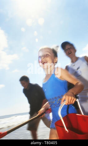 Kids running on a beach, Skegness, Lincolnshire, England, UK - Stock Image