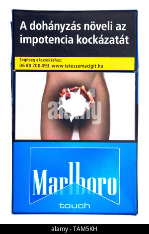 packet of hungarian marlboro cigarettes with graphic health warning picture on the front cut out on white background - Stock Image