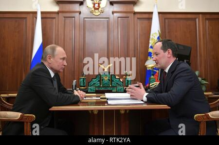 Russian President Vladimir Putin during a working meeting with Director General of the national grid company Rosseti Pavel Livinsky at the Kremlin March 1, 2019 in Moscow, Russia. - Stock Image