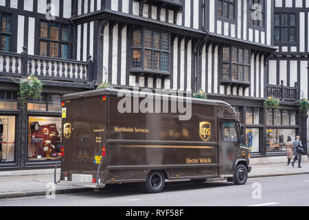 An electric UPS delivery van outside Liberty's department store in London. - Stock Image