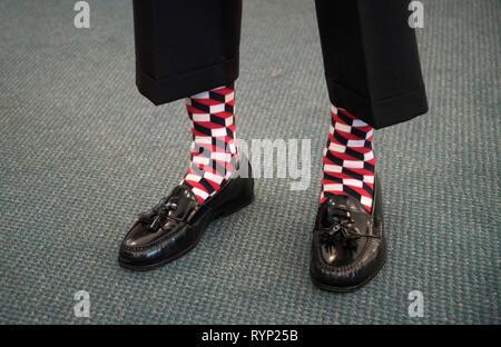 Man wearing his 'Happy Socks'. - Stock Image