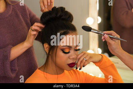 Open workshop hairdressing. Master class makeup art shows on model. Fashion professional. Practice skills obtained at vocational training centre. vlog - Stock Image