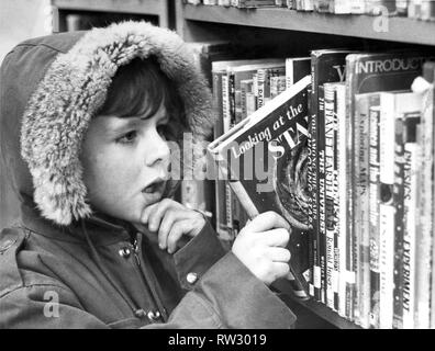 Five year old Christopher Blanks makes his reading selection at Low Fell library at Gateshead in January 1972 - Stock Image