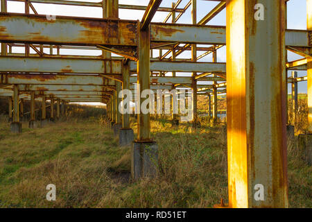 rusting rolled steel joist skeleton of a building - Stock Image