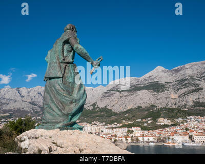 Editorial - Saint Peter monument in front of Makarska city on sunny day - Stock Image