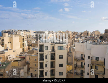 View over the rooftops in the densely built up and populated district of Sliema In Malta - Stock Image