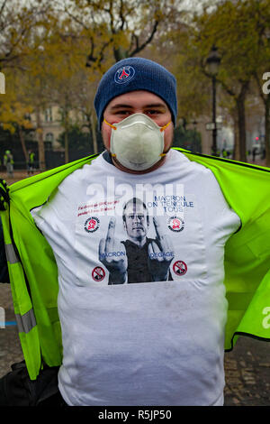 Paris, France. 1st December, 2018.  Yellow vest protester with a tshirt showing Emmanuel Macron with a text 'Macron out', 'Macro fuck off' during the Yellow Vests protest against Macron politic. Credit: Guillaume Louyot/Alamy Live News - Stock Image