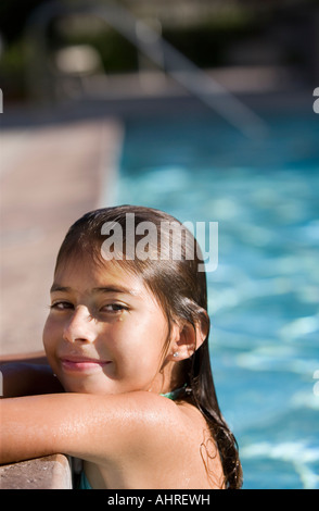 young latin girl in a bathing suit in the swimming pool - Stock Image