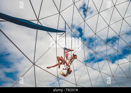 Couple team peole of acrobatice air dance traing together for perfect exhibition balanced and synchro - alternative sport athlete beautiful uoung woma - Stock Image