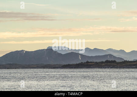 Sunrise over the mountains from a Norwegian fjord near Trondheim. - Stock Image