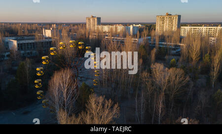 Drone image taken over the amusement park at Pripyat, Ukraine, inside the Chernobyl Exclusion Zone - Stock Image