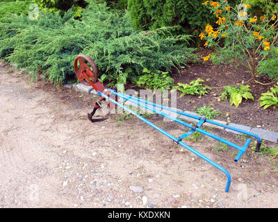 Pushed by hands garden cultivator or tiller on ground - Stock Image