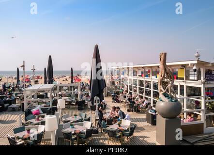 People at Scheveningen beach, a popular coast location close to the The Hague (Den Haag), Netherlands. - Stock Image