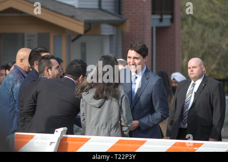 Canadian Prime Minister Justin Trudeau greeting a crowd in Maple Ridge after addressing the media about affordable housing. - Stock Image
