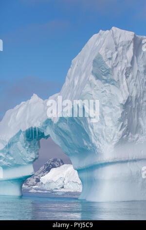 Iceberg with arch, Antarctica. - Stock Image
