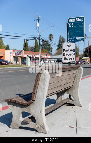 Bench by busstop, Maude Avenue, Sunnyvale, California, USA - Stock Image