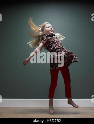 girl 3-5 jumping,  studio shot - Stock Image