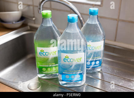 Plastic containers bottles of Ecover environmentally friendly washing-up liquid on kitchen window, England, UK - Stock Image