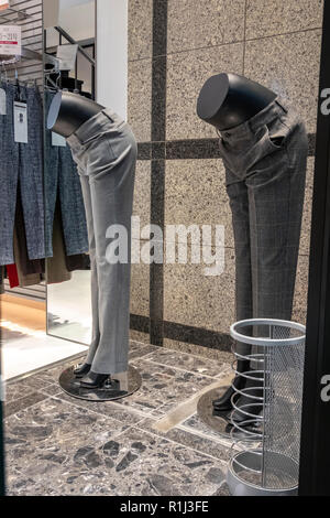 Traditional Japanese Bowing. Even these two shop mannequins are bowing in Japan, greeting visitors in a Kyoto fashion store on Teramachi Street. - Stock Image
