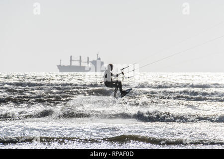 Marazion, Cornwall, UK. 21st Feb, 2019. UK Weather. Temperatures were upto 14.5 degrees C this lunchtime on the beach at Marazion, for half term week. Kite surfers were making the most of the stiff breeze. Credit: Simon Maycock/Alamy Live News - Stock Image