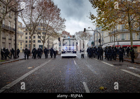 Paris, France. 1st December, 2018. Police force walking during the Yellow Vests protest against Macron politic. Credit: Guillaume Louyot/Alamy Live News - Stock Image