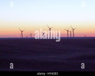 Wind Turbines In Sea During Sunset - Stock Image