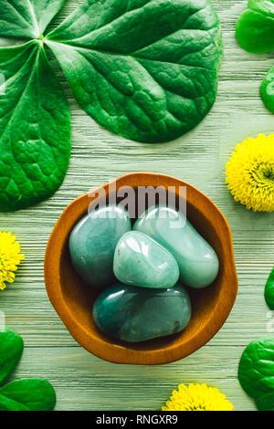 Green Aventurine Shamrocks and Yellow Chrysanthemums - Stock Image