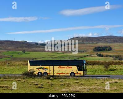 Memory Lane Holidays and  Travel Coach. M6 Northbound carriageway, Shap, Cumbria, England, United Kingdom, Europe. - Stock Image