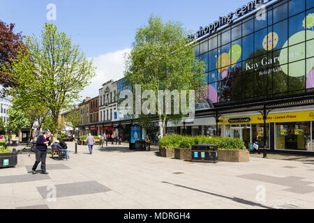 Shops and people in a largely clean and tidy Kay Gardens Retail Walk, in the town centre of Bury, Greater Manchester. - Stock Image
