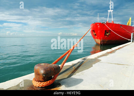 red cargo in the port in the afternoon - Stock Image